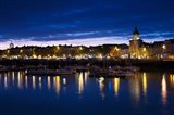 Buildings at the waterfront lit up at dusk, Old Port, La Rochelle, Charente-Maritime, Poitou-Charentes, France