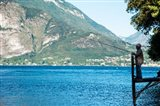 Man Fishing from Dock on Edge of Lake Como, Varenna, Lombardy, Italy