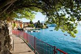 Walkway along the shore of a lake, Varenna, Lake Como, Lombardy, Italy