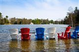 Adirondack chairs partially submerged in the Lake Muskoka, Ontario, Canada