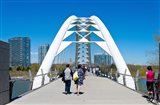 People strolling on Humber Bay Arch Bridge, Toronto, Ontario, Canada