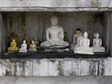 Niche at Ruwanwelisaya Dagoba filled with Buddha statues as offerings, Anuradhapura, Sri Lanka