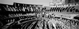 High angle view of tourists in an amphitheater, Colosseum, Rome, Italy BW