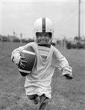 1950s Boy In Oversized Shirt And Helmet