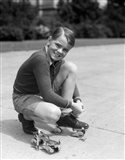 1930s Smiling Boy Fastening On Metal Roller Skates