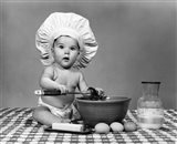 1960s Baby Seated On Checkered Tablecloth