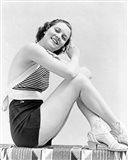 1930s  Smiling Brunette Woman Wearing Striped Halter Top