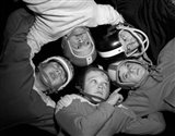 1960s Five Boys In Huddle Wearing Helmets & Football Jerseys