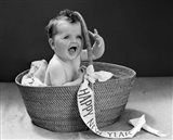 1940s Baby In Wicker Basket With Happy New Year Banner