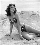 1950s 1960s Brunette Bathing  Stretched Out On Sand?