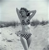 1950s Brunette Beauty In Polka Dot Bikini Standing In Sand