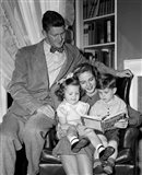 1940s Father Watching  Mother Reading To Son And Daughter