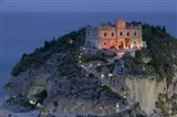 High angle view of a church lit up at dusk on a cliff, Santa Maria dell Isola, Tropea, Calabria, Italy