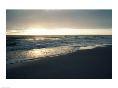 Waves breaking on the beach at sunrise Poster by Unknown for $31.25 CAD