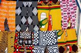 Africa, Angola, Benguela. Bright colored pants for sale at local shop. Art Print