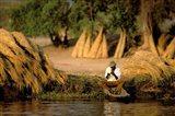 Local Man Fishing and Piles of Straw for Hatch, Okavango Delta, Botswana Art Print