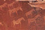 Ancient rock etchings, Twyfelfontein, Damaraland, Namibia, Africa. Art Print