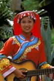 Ethnic Dancer Playing Guitar, Kunming, Yunnan Province, China Art Print
