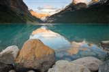 Rocky Mountains and boulders reflected in Lake Louise, Banff National Park, Alberta, Canada Art Print