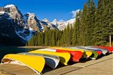 Moraine Lake and rental canoes stacked, Banff National Park, Alberta, Canada Art Print