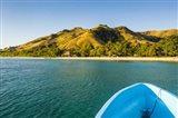 Blue boat cruising through the Yasawa, Fiji, South Pacific Art Print