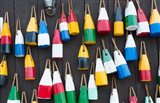 Colorful Buoys Hanging On Wall, Bar Harbor, Maine Art Print