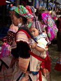 Flower Hmong woman carrying baby on her back, Bac Ha Sunday Market, Lao Cai Province, Vietnam Art Print