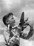1930s 1940s 1950s  Freckle-Faced Boy Holding Airplane Art Print