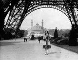 1920s Woman Walking Under The Eiffel Tower Art Print