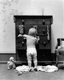 1940s Toddler Baby Pulling Clothes Out Of Bureau Art Print