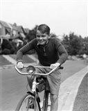 1930s Smiling Boy Riding Bicycle Art Print