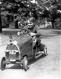 1930s Boy Driving Home In Race Car Art Print