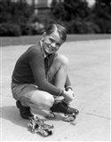 1930s Smiling Boy Fastening On Metal Roller Skates Art Print
