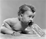 1950s Baby Leaning Forward Drinking From Bottle Art Print