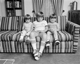 1970s Three Siblings Sitting On Couch Art Print