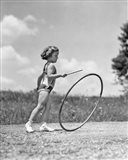1930s Girl Outdoors Playing Hoop And Stick Game Art Print