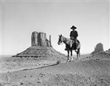 Navajo Indian In Cowboy Hat On Horseback With Monument Valley Rock Formations In Background Art Print