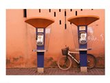 Public telephone booths in front of a wall, Morocco Art Print