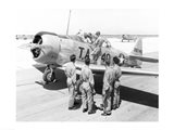 Rear view of four soldiers standing near a fighter plane, T-6 Texan Art Print