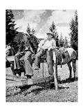 Teenage cowboys sitting on rail fence Art Print