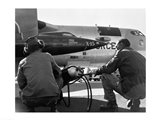 Rear view of two men crouching near fighter planes, X-15 Rocket Research Airplane, B-52 Mothership Art Print