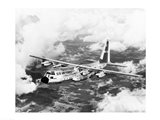 High angle view of a military airplane in flight, C-130 Hercules Art Print
