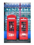 Two telephone booths near a grille, London, England Art Print