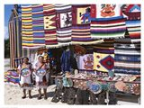 Two female vendors dressed in Mayan costumes displaying products Art Print
